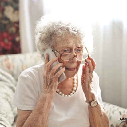 woman answering telephone
