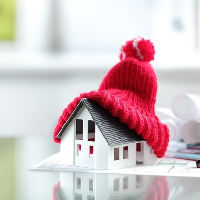 Model of a house with a woolly hat