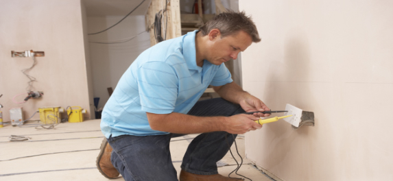 electrician fixing a plug