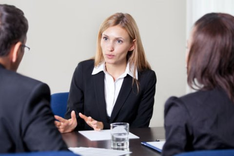 Lady holds meeting at a desk