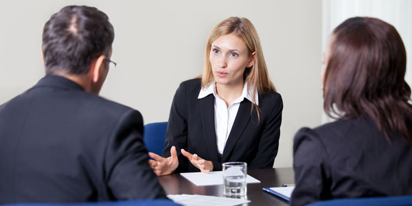 A woman holds a meeting