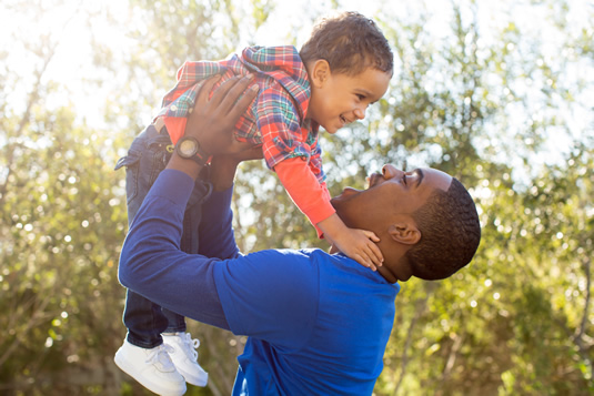 man lifting a child