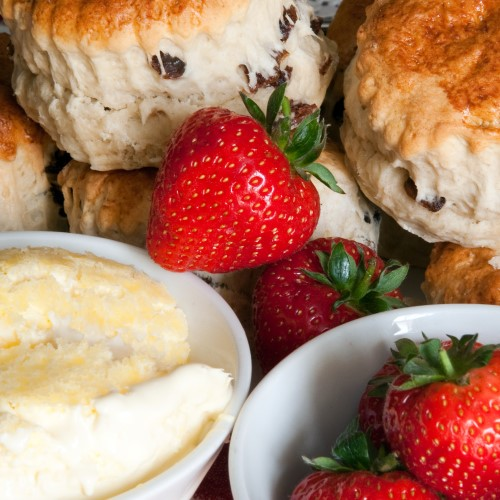 Fruit scones with strawberries and cream
