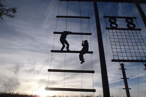 silhouette of rope climbing