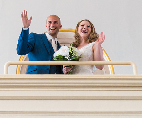 Couple waving at Royal Victoria Chapel