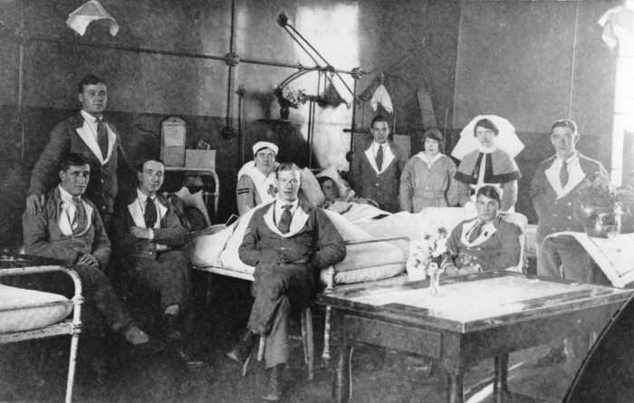 Patients and nurses in a hospital ward