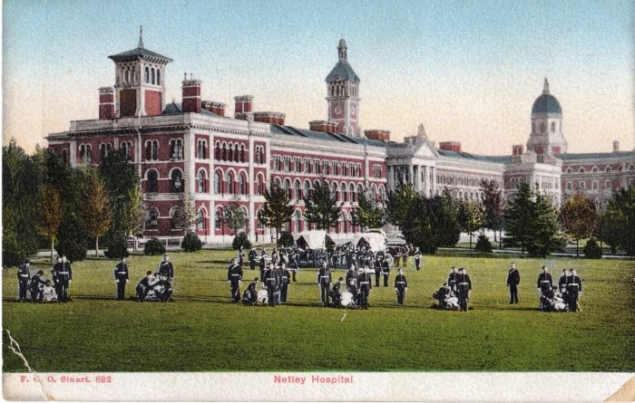 Stretcher drill on the field by the west wing of the hospital, c1900
