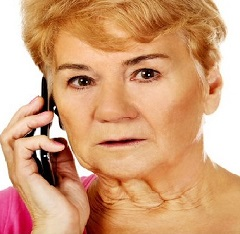 Image of female lady with blonde short hair on the telephone