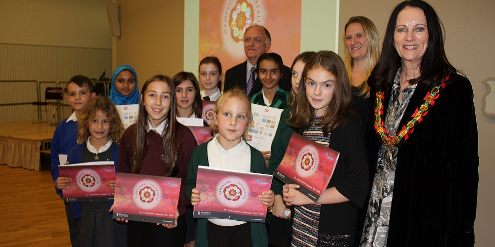 Cllr Andrew Joy, Cllr Roz Chadd and HCC Chairman Cllr Elaine Still with Interfaith calendar prize winners