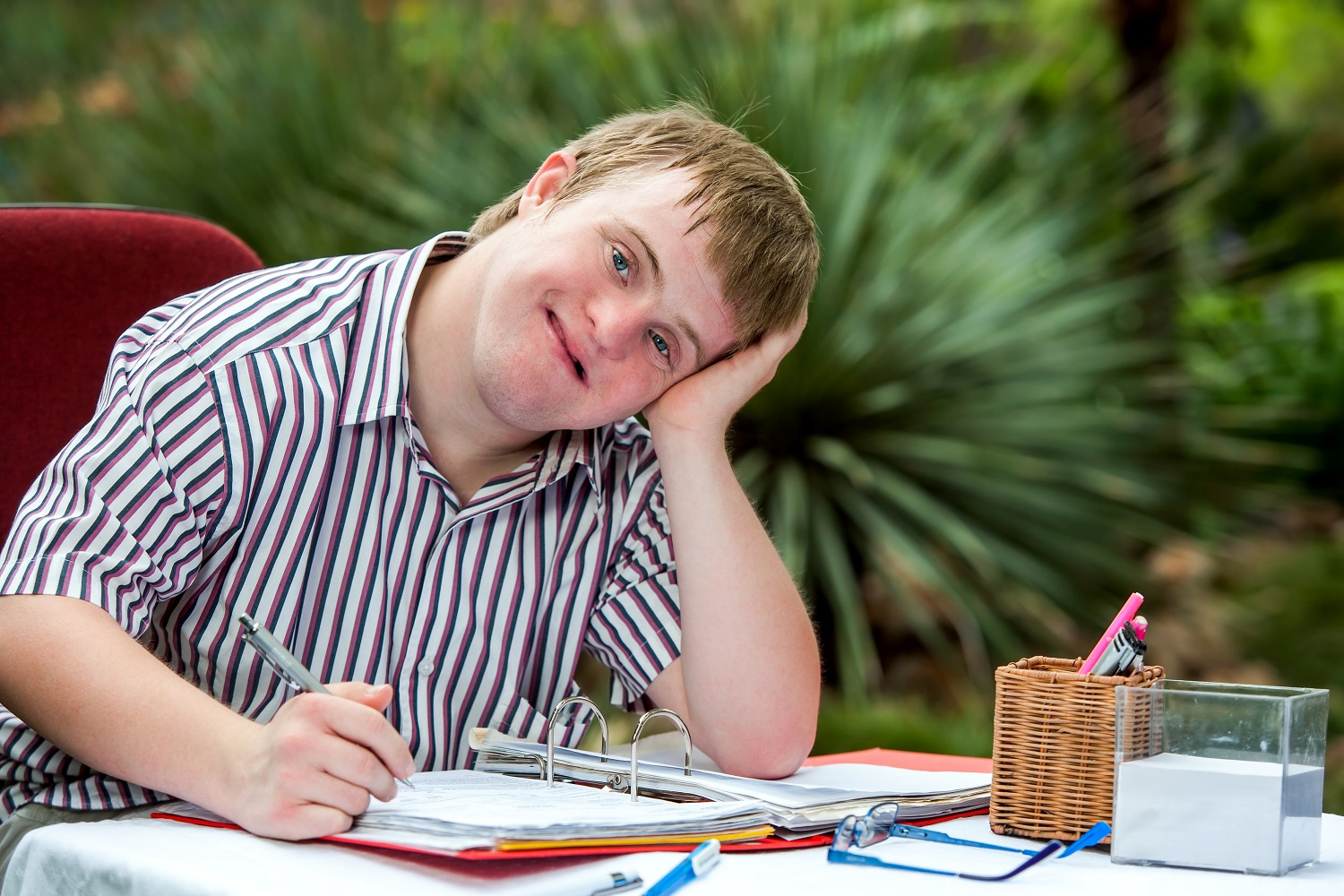 Image of a boy with special needs writing