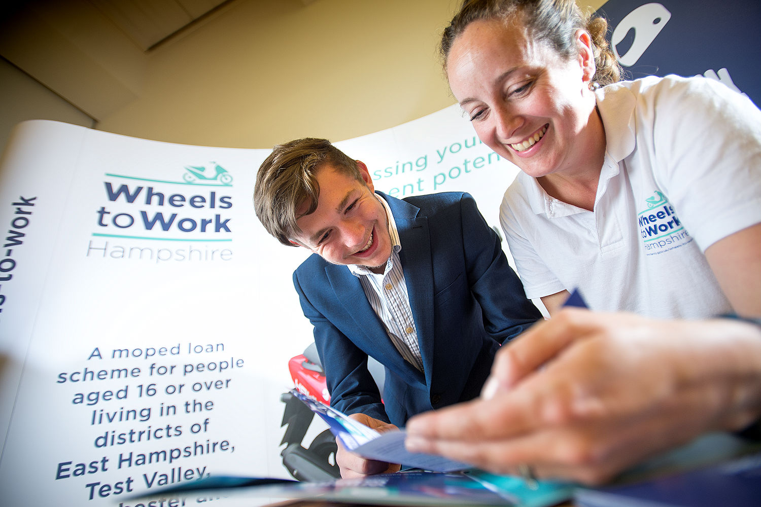Young person with a Wheels to Work advisor