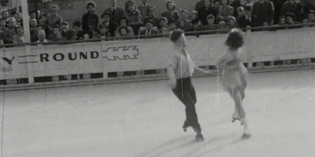 Man and woman performing roller skating routine