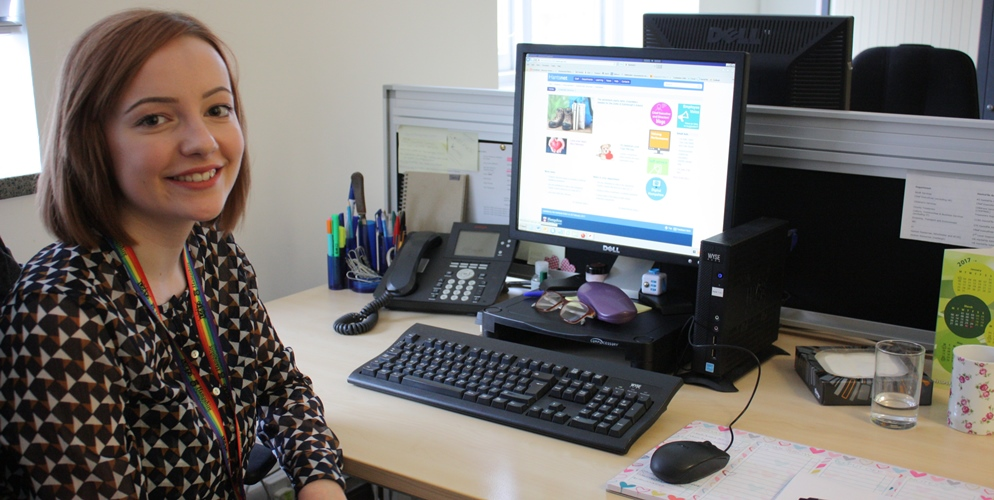 Apprentice Lucy Guyatt sitting at her desk