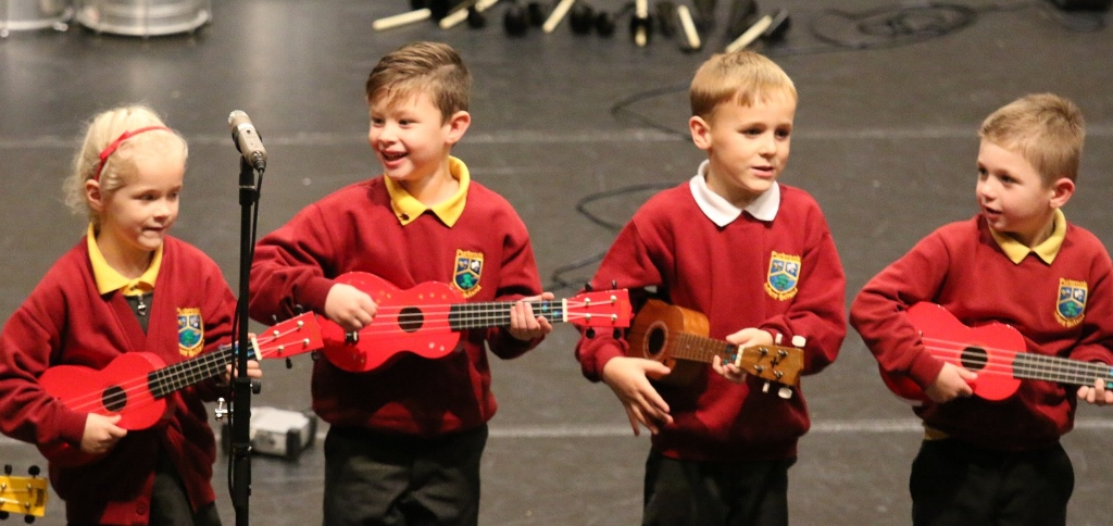 Children performing in the ukulele ensemble