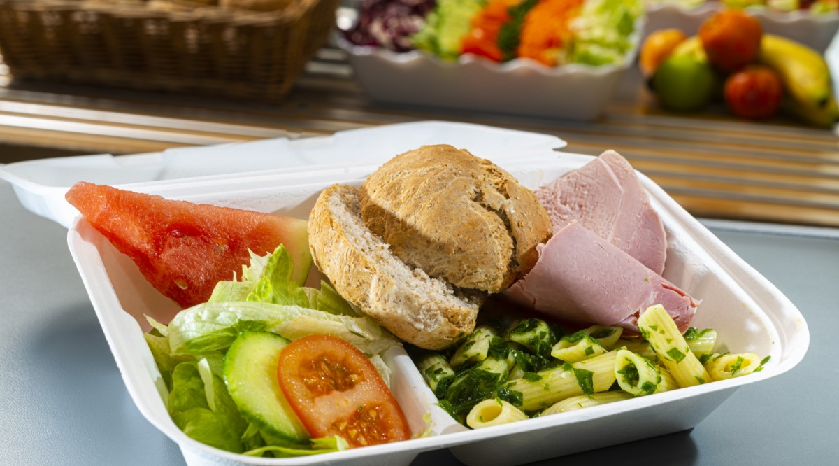 Ham salad and bread roll in sustainable packaging