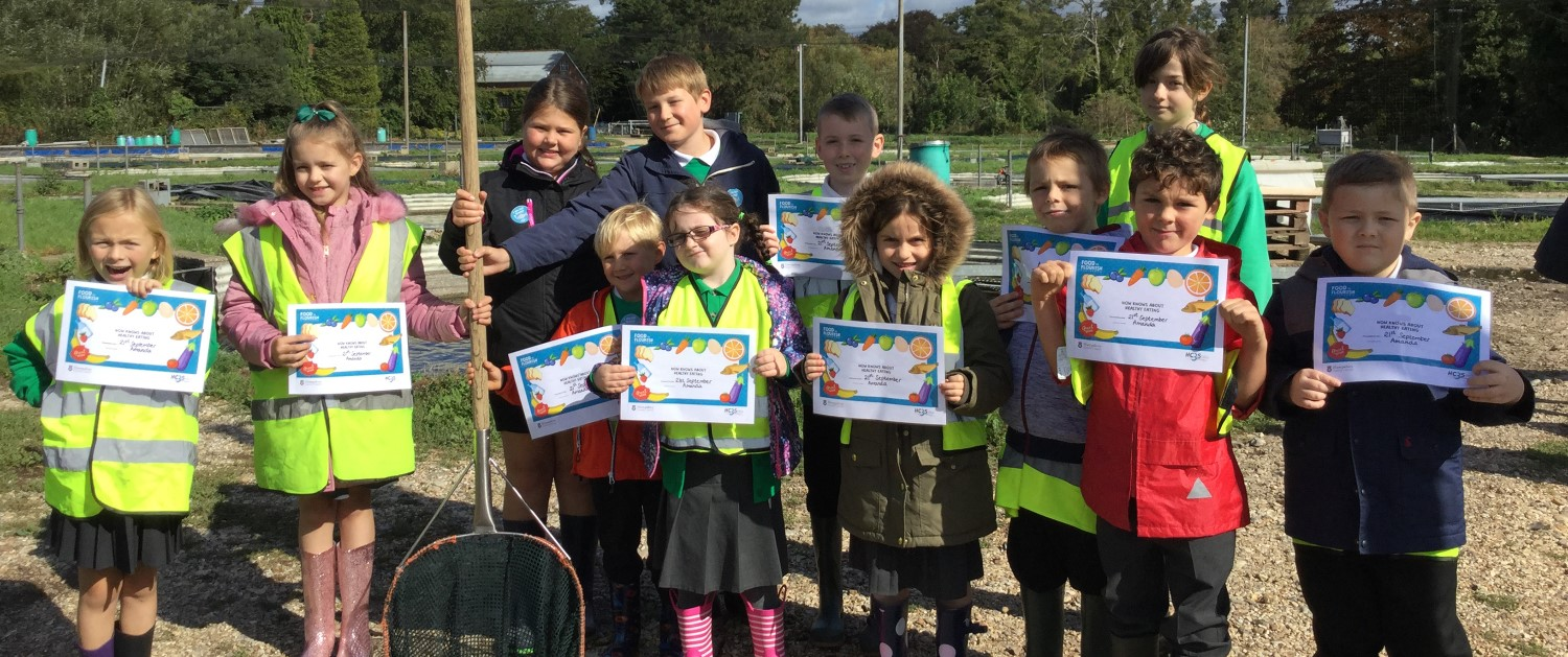School children holding their healthy eating certificates