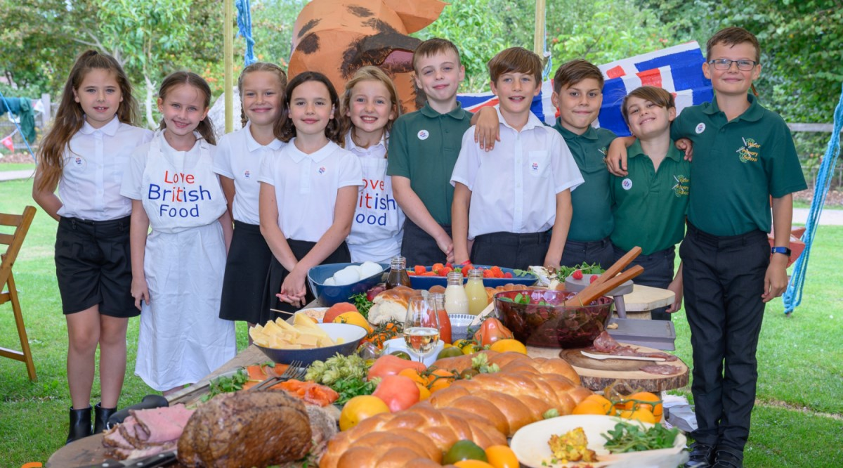 Children from the Wicor School in front of a table of food