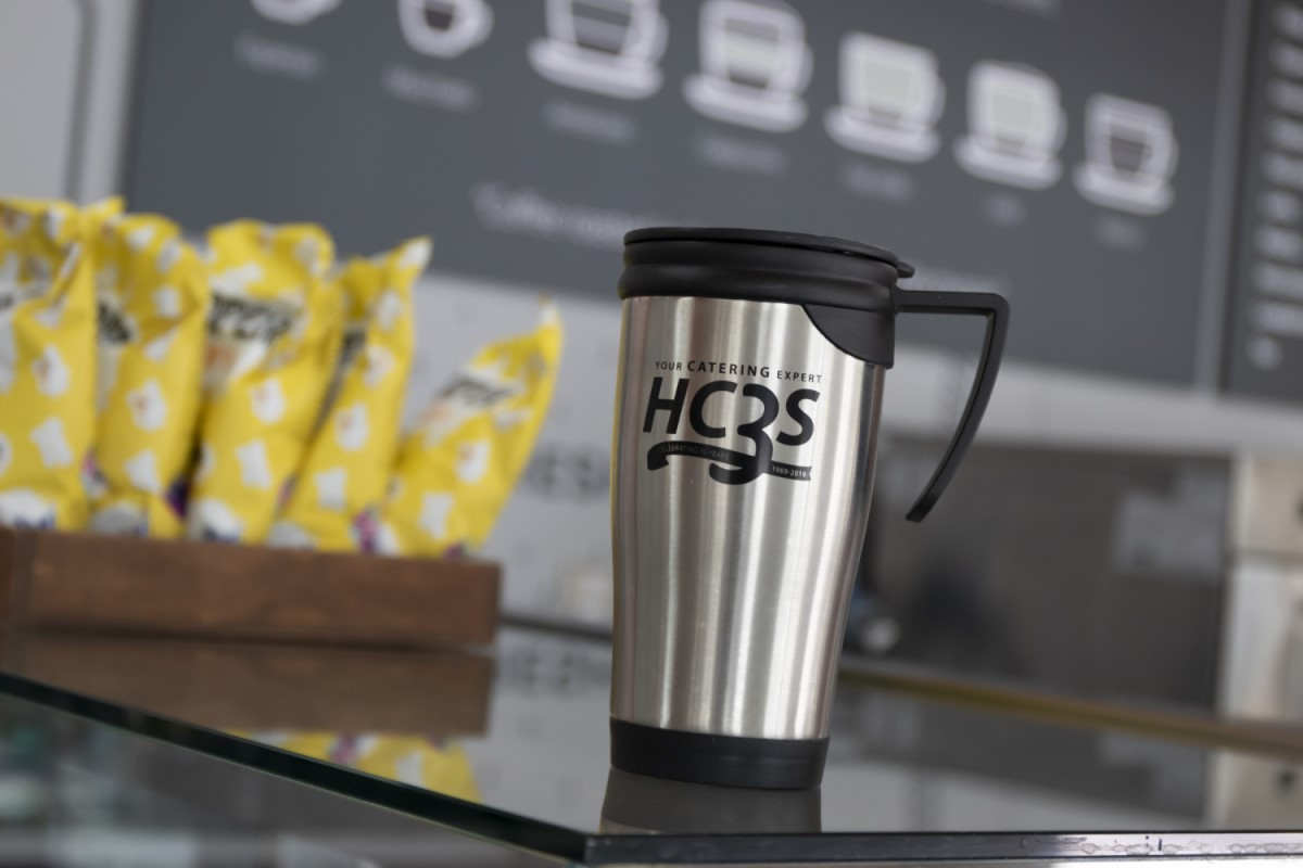Hand reaching out for a reusable coffee cup