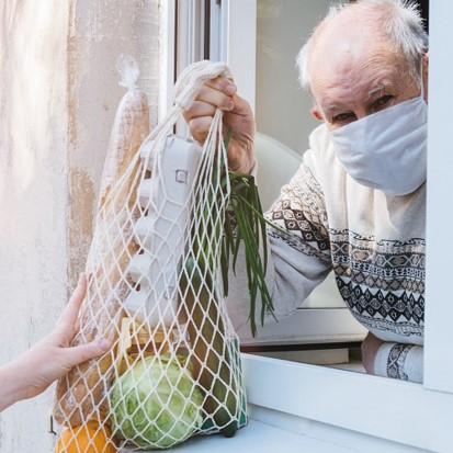 Man receiving grocery bag